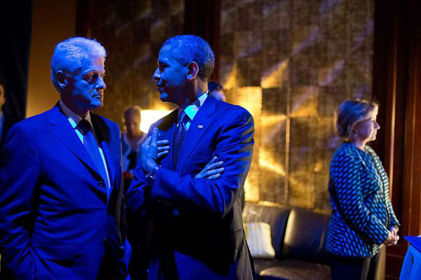 Sept. 24, 2013: The President and former President Bill Clinton are bathed in blue light as they talk backstage prior to participating in the Clinton Global Initiative Healthcare Forum in New York City. Former Secretary of State Hillary Rodham Clinton, right, waits to introduce them.   <span class=meta>(Official White House Photo by Pete Souza)</span>