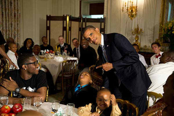 June 14, 2013: The President called me over to pose for a photo with a young boy who had fallen asleep during the Father&#39;s Day ice cream social in the State Dining Room of the White House.  <span class=meta>(Official White House Photo by Pete Souza)</span>