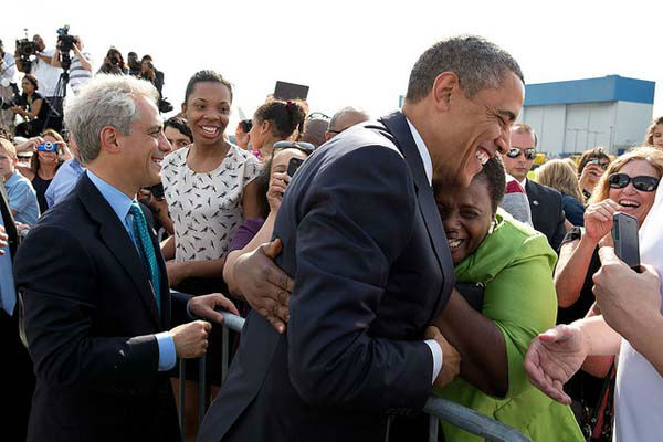 May 29, 2013: A woman hugs the President as he and Chicago Mayor Rahm Emanuel greeted people on the tarmac at O&#39;Hare International Airport in Chicago.  <span class=meta>(Official White House Photo by Pete Souza)</span>