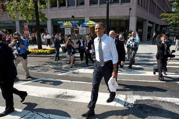 Oct. 4, 2013: The President walks back to the White House from Taylor Gourmet, a sandwich shop near the intersection of 17th and Pennsylvania Avenues, Washington, D.C. The President wanted to thank the sandwich shop for offering discounts to furloughed government workers during the shutdown.  <span class=meta>(Official White House Photo by Pete Souza)</span>