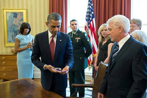 April 11, 2013: The President holds Chaplain &#40;Captain&#41; Emil Kapaun&#39;s Easter stole during a greet with Father Kapaun&#39;s family in the Oval Office, before posthumously awarding him the Medal of Honor. After being captured by the Chinese military in 1950, Father Kapaun was taken to a North Korean prison camp, where he later died but not before he held an Easter service and said prayers for his captors.    <span class=meta>(Official White House Photo by Pete Souza)</span>