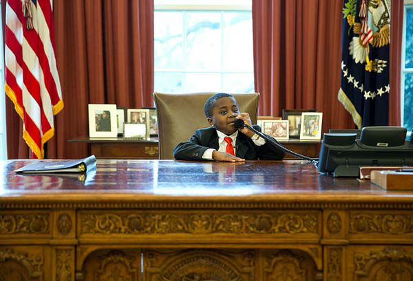 April 1, 2013: Robby Novak, AKA &#39;Kid President&#39;, feigns a phone call at the Resolute Desk during his visit to see the President in the Oval Office. &#39;Kid President&#39; became a YouTube sensation and was invited to participate in the Easter Egg Roll at the White House.  <span class=meta>(Official White House Photo by Pete Souza)</span>