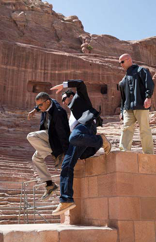 March 23, 2013: While touring the ancient city of Petra in Jordan, the President and Dr. Suleiman A.D. Al Farajat, a University of Jordan tourism professor, jumped from a ledge of the Nabataean Amphitheater.  <span class=meta>(Official White House Photo by Pete Souza)</span>