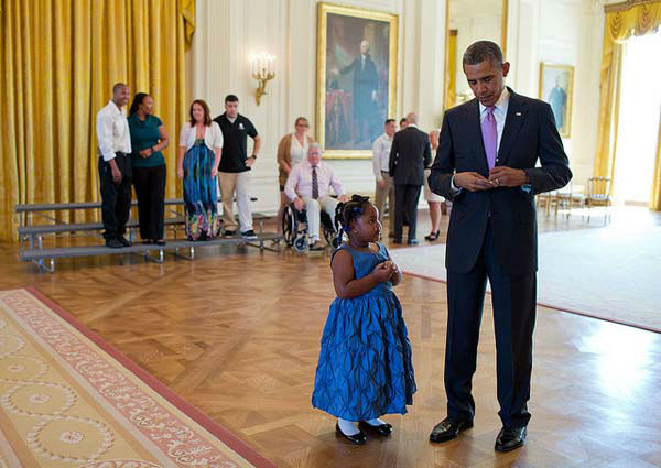 Sept. 19, 2013: I loved the look Alanah Poullard&#39;s face as the President wrote a school excuse note for the five-year-old, while visiting with Wounded Warriors and their families in the East Room during their tour of the White House. Alanah asked for a note to show her kindergarten teacher so she wouldn&#39;t get in trouble for missing a school day.   <span class=meta>(Official White House Photo by Pete Souza)</span>