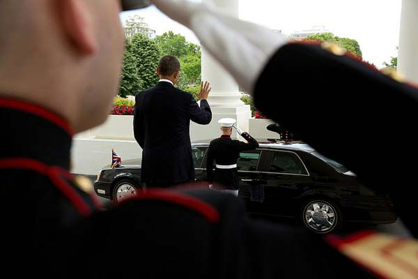 May 13, 2013: The President waves farewell to British Prime Minister David Cameron as his motorcade departs the North Portico of the White House.   <span class=meta>(Official White House Photo by Pete Souza)</span>