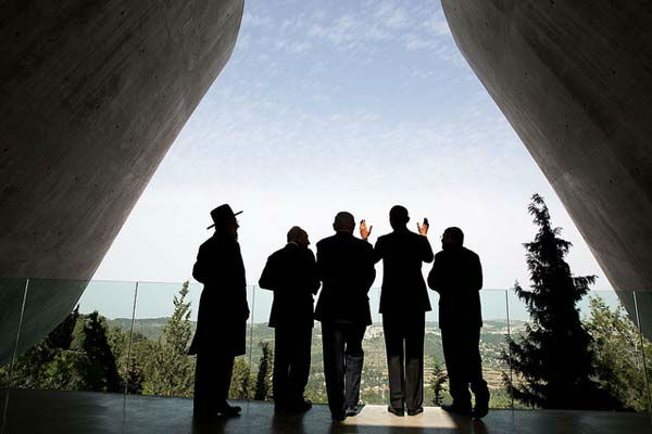 March 22, 2013: The President was visiting the Yad Vashem Holocaust History Museum with Israeli President Shimon Peres, Israeli Prime Minster Benjamin Netanyahu, and others. When the President asked a question about the cityscape in the background, the sunlight lit up his hands adding another dimension to this photograph.   <span class=meta>(Official White House Photo by Pete Souza)</span>