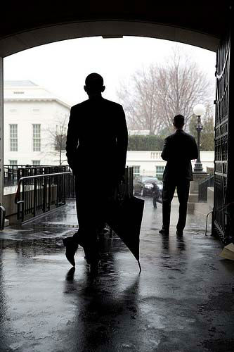 March 12, 2013: The President leans on an umbrella as he waited for heavy rain to let up before crossing from the Eisenhower Executive Office Building to the West Wing of the White House. Most of the staff and Secret Service with the President didn&#39;t have umbrellas so he waited for the rain to subside before crossing. I was behind the President, hoping that someone with an umbrella would walk by in the background to add another element to the photograph.  <span class=meta>(Official White House Photo by Pete Souza)</span>