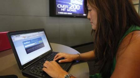 In this Aug. 6, 2009 file photo, college student Joy Troy checks a twitter page at the Annenberg School of Communication department at the University of Southern California campus in Los Angeles. (AP Photo/Damian Dovarganes, File)
