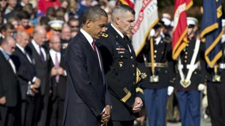 During a solemn Veterans Day ceremony, President Barack Obama presents a wreath at the Tomb of the Unknowns at Arlington National Cemetery in Arlington, Va., Sunday, Nov. 11, 2012. He is accompanied by Maj. Gen. Michael S. Linnington, commander of the U.S. Army Military District of Washington.