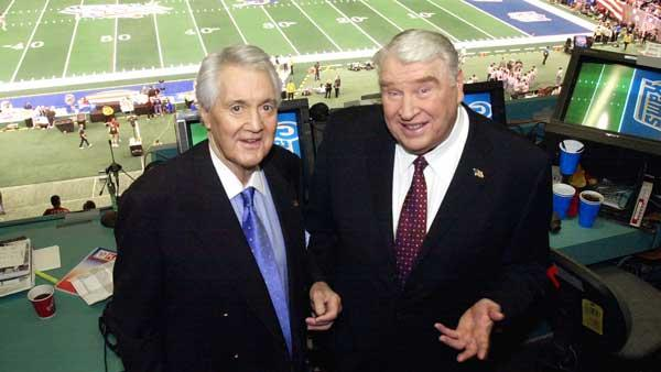 In this file photo, Fox broadcasters Pat Summerall, left, and John Madden stand in the FOX broadcast booth at the Louisiana Superdome before Super Bowl XXXVI in New Orleans.