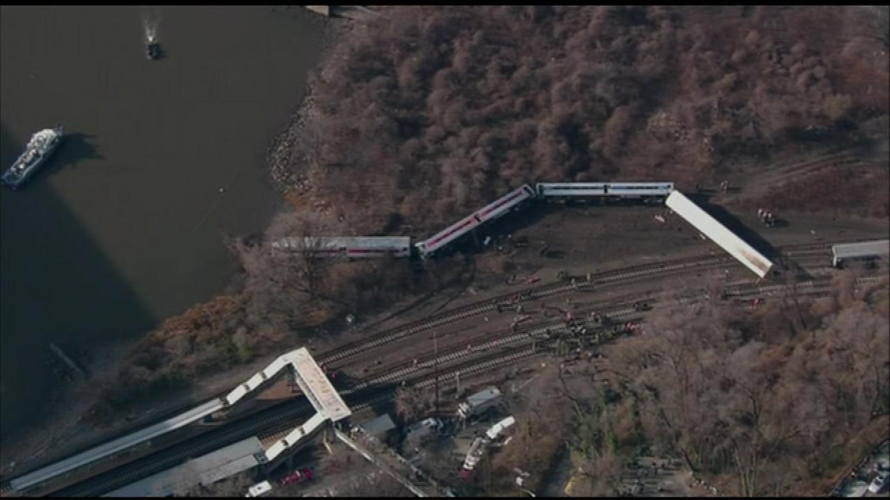 A commuter train derailed in New York City Sunday near the Hudson River leaving four dead and at least 60 injured.