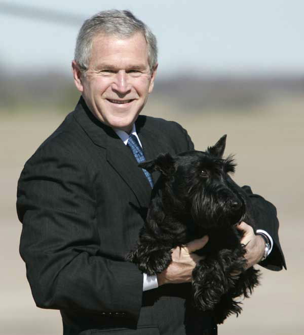 President Bush carries his dog Barney across the airport tarmac in Waco, Texas, Tuesday, Dec. 26, 2006. Bush is spending a week at his ranch in Crawford, Texas.  &#40;AP Photo&#47;Evan Vucci&#41; <span class=meta>(AP Photo&#47; EVAN VUCCI)</span>