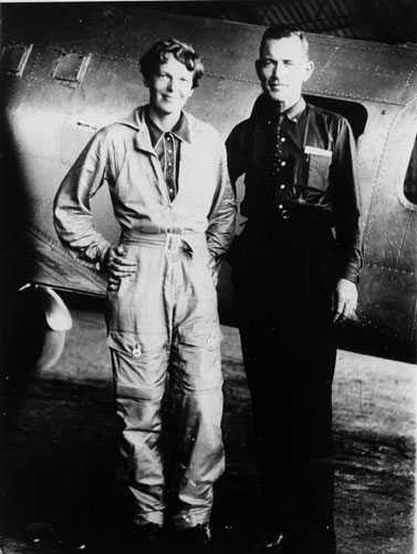 Famed aviator Amelia Earhart and her navigator, Fred Noonan, pose in this file photo in front of their twin-engine Lockheed Electra in Los Angeles at the end of May, 1937, prior to their historic flight in which Earhart was attempting to become first female pilot to circle the globe. A clear plastic shard found on Nikumaroro island in 1977 matches thickness and curvature of the Lockheed Electra windows.  <span class=meta>(&#40;AP Photo, File&#41;)</span>