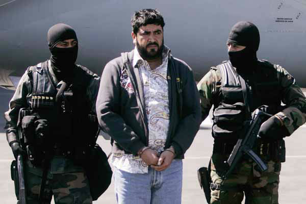 ** FOR STORY SLUGGED NARCOTRAFICO-APODOS ** FILE - In this Jan. 21, 2008 file photo Mexican federal police officers escort Alfredo Beltran Leyva, known as &#34;El Mochomo&#34;, after his arrest upon his arrival to Mexico City&#39;s airport.  &#34;El mochomo&#34; is a big, biting ant in northwestern Mexico. &#40;AP Photo&#47;Eduardo Verdugo, File&#41; <span class=meta>(AP Photo&#47; Eduardo Verdugo)</span>