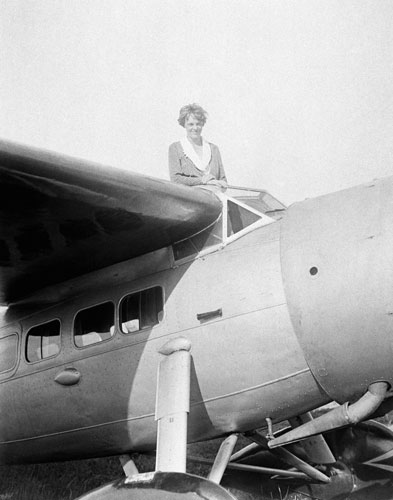 In this undated photo, Amelia Earhart, the first woman to cross the Atlantic Ocean by plane sits on top of a plane. Secretary of State Hillary Rodham Clinton is wading into one of the 20th century&#39;s most enduring mysteries: the fate of American aviator Amelia Earhart, disappeared over the South Pacific 75 years ago. Clinton is meeting March 20, 2012, with historians and scientists from The International Group for Historic Aircraft Recovery, which will launch a new search in June for the wreckage of Earhart&#39;s plane off the remote island of Nikumaroro.  <span class=meta>(AP Photo)</span>