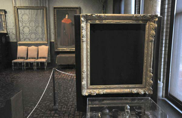 FILE - In this Thursday, March 11, 2010 file photo, empty frames from which thieves took &#34;Storm on the Sea of Galilee,&#34; left background, by Rembrandt and &#34;The Concert,&#34; right foreground, by Vermeer, remain on display at the Isabella Stewart Gardner Museum in Boston. The paintings are among 13 works stolen by burglars from the museum in the early hours of March 18, 1990. The FBI said Monday, March 18, 2013, it believes it knows the identities of the thieves who stole the art. Richard DesLauriers, the FBI&#39;s special agent in charge in Boston, says the thieves belong to a criminal organization based in New England the mid-Atlantic states.  &#40;AP Photo&#47;Josh Reynolds, File&#41; <span class=meta>(AP Photo&#47; Josh Reynolds)</span>
