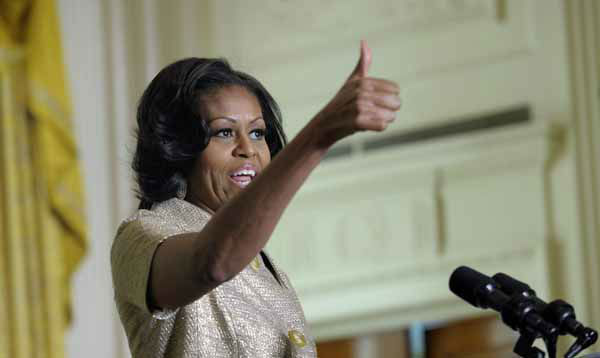 "<div class=""meta ""><span class=""caption-text "">First lady Michelle Obama gives a thumbs up to those who decorated the White House as she speaks to military families in the East Room of the White House in Washington, Wednesday, Nov. 28, 2012. The theme for the White House Christmas 2012 is Joy to All.  (AP Photo/Susan Walsh) (AP Photo/ Susan Walsh)</span></div>"