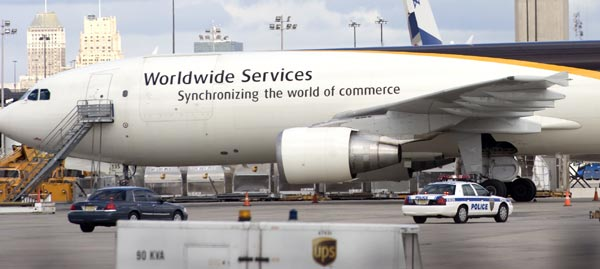 Authorities respond to the United Parcel Service staging area at Newark Liberty International Airport where a cargo plane was searched and a suspicious package removed Friday, Oct. 29, 2010, in Newark, N.J.  (AP Photo/Joe Epstein)