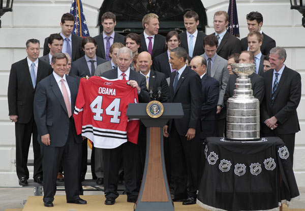 President Barack Obama, right, is presented a team jersey during a ceremony to honor the 2009-2010 NHL Stanley Cup Champion Chicago Blackhawks in the South Lawn of the White House in Washington, Friday, March, 11, 2011. Presenting Obama the jersey are Blackhawks president John McDonough, center, and Blackhawks chairman W. Rockwell 'Rocky' Wirtz, left. (AP Photo/Pablo Martinez Monsivais)