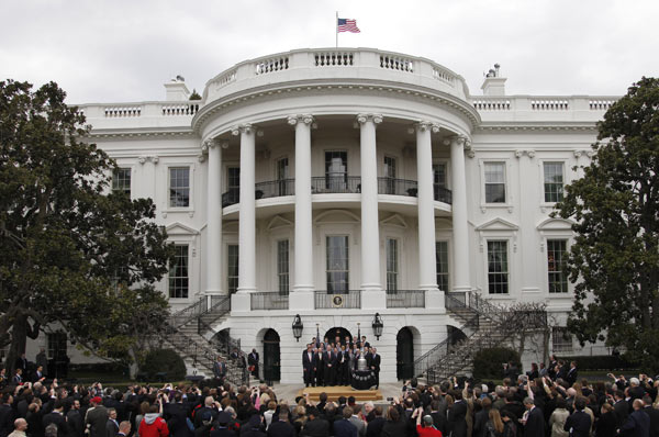 President Barack Obama, center, poses for a group photo during a ceremony to honor the 2009-2010 NHL Stanley Cup Champion Chicago Blackhawks in the South Lawn of the White House in Washington, Friday, March, 11, 2011. (AP Photo/Pablo Martinez Monsivais)