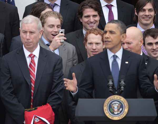 Blackhawks Patrick Kane, left, reacts as he makes a video of President Barack Obama, right, during a ceremony to honor the 2009-2010 NHL Stanley Cup Champion Chicago Blackhawks in the South Lawn of the White House in Washington, Friday, March, 11, 2011. (AP Photo/Pablo Martinez Monsivais)