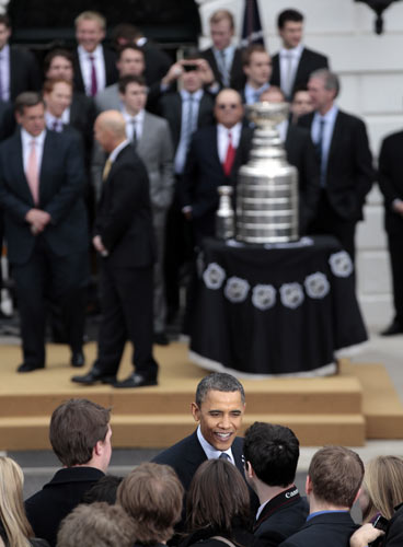 President Barack Obama, center, greets guest following a ceremony to honor the 2009-2010 NHL Stanley Cup Champion Chicago Blackhawks in the South Lawn of the White House in Washington, FridayMarch, 11, 2011. (AP Photo/Pablo Martinez Monsivais)