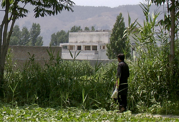 Osama bin Laden lived in five safe houses while on the run in Pakistan and fathered four children -- two of them born in government hospitals, his youngest widow has told investigators. In this  June 15, 2011, photo, a local resident walks near a house where bin Laden was caught and killed in Abbottabad, Pakistan on May 2, 2011. &#40;AP Photo&#47;Aqeel Ahmed&#41; <span class=meta>(AP Photo&#47; Aqeel Ahmed)</span>