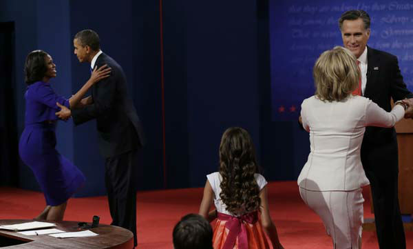 Left, President Barack Obama  hugs his wife Michelle with Republican presidential nominee Mitt Romney hugs his wife Ann following the first presidential debate at the University of Denver, Wednesday, Oct. 3, 2012, in Denver. &#40;AP Photo&#47;Eric Gay&#41; <span class=meta>(AP Photo&#47; Eric Gay)</span>