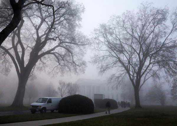 An early morning thick fog envelopes the White House in Washington, Monday, April 1, 2013, prior to the start of the annual Easter Egg Roll. &#40;AP Photo&#47;Jacquelyn Martin&#41; <span class=meta>(AP Photo&#47; Jacquelyn Martin)</span>