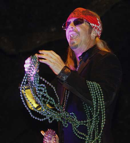 ntertainer Bret Michaels holds a handful of beads while riding in the Mardi Gras parade in New Orleans, Monday, Feb. 20, 2012.  <span class=meta>(AP Photo&#47;Bill Haber)</span>