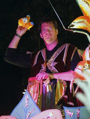 Harry Connick tosses throws while riding in the Mardi Gras parade in New Orleans, Monday, Feb. 20, 2012. <span class=meta>(AP Photo&#47;Bill Haber)</span>