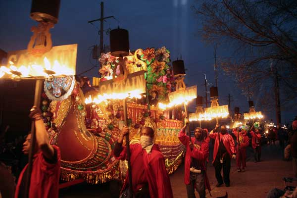 Fleambeaux Carriers march along side the Captain&#39;s float in the Mardi Gras parade in New Orleans, Monday, Feb. 20, 2012. <span class=meta>(AP Photo&#47;Bill Haber)</span>