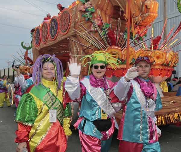 Riders in the Mardi Gras parade make their way to their float in the staging area of the parade in New Orleans, Monday, Feb. 20, 2012.  <span class=meta>(&#40;AP Photo&#47;Bill Haber&#41;)</span>