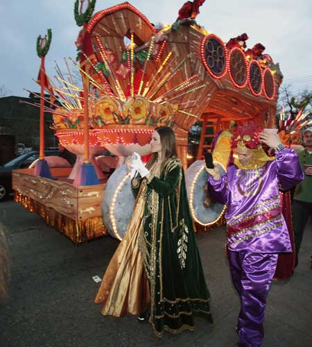 "<div class=""meta ""><span class=""caption-text "">Actress Hillary Swank walks to her float in the staging area before the start of the Mardi Gras parade in New Orleans, Monday, Feb. 20, 2012.  (AP Photo/Bill Haber)</span></div>"