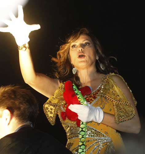 Actress Mariska Hargitay tosses throws while riding in the Mardi Gras parade in New Orleans, Monday, Feb. 20, 2012.  <span class=meta>(AP Photo&#47;Bill Haber)</span>