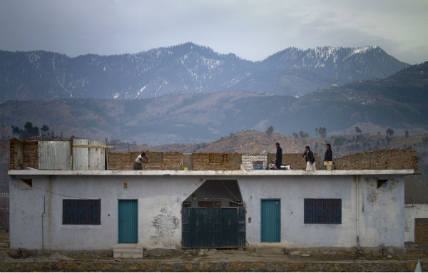 Since the raid that killed bin Laden, it has been known that he lived mostly in Pakistan since 2002.   Al-Sada&#39;s account says she flew to Pakistan in 2000 and traveled to Afghanistan where she married bin Laden before the Sept. 11 attacks. In this file photo, Pakistani youngsters play cricket on the rooftop of their house near the compound of Osama bin Laden  which is demolishing by authorities in Abbottabad, Pakistan on Sunday, Feb. 26, 2012.  &#40;AP Photo&#47;Anjum Naveed&#41; <span class=meta>(AP Photo&#47; Anjum Naveed)</span>