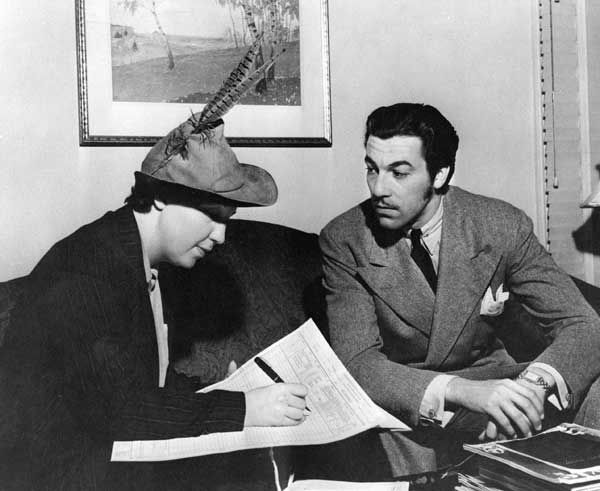 In this photo provided by the National Archives at College Park, an enumerator interviews actor Cesar Romero, right, to get data for the 1940 Census. Veiled in secrecy for 72 years because of privacy protections, the 1940 U.S. Census is the first historical federal decennial survey to be made available on the Internet initially rather than on microfilm. &#40;AP Photo&#47;National Archives at College Park&#41;  <span class=meta>(AP Photo)</span>