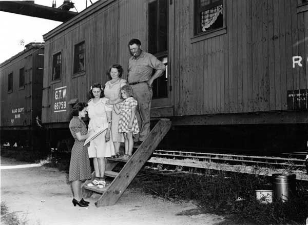 In this photo provided by the National Archives at College Park, an enumerator, left, interviews a family outside a rail car for the 1940 Census. Veiled in secrecy for 72 years because of privacy protections, the 1940 U.S. Census is the first historical federal decennial survey to be made available on the Internet initially rather than on microfilm. &#40;AP Photo&#47;National Archives at College Park&#41; <span class=meta>(AP Photo)</span>
