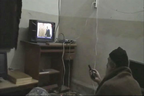 FILE - This undated image from video seized from the walled compound of al-Qaida leader Osama bin Laden in Abbottabad, Pakistan and released by the U.S. Department of Defense shows a man identified by the U.S. government as Osama Bin Laden in front of a television. Bin Laden spent his last weeks in a house divided, amid wives riven by suspicions. On the top floor, sharing his bedroom, was his youngest wife and favorite. The trouble came when his eldest wife showed up and moved into the bedroom on the floor below &#40;AP Photo&#47;Department of Defense, File&#41; <span class=meta>(AP Photo&#47; Anonymous)</span>