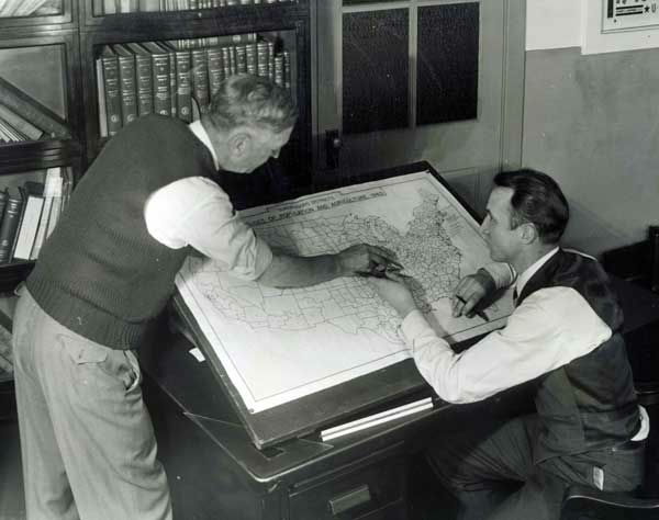 In this undated photo provided by the Franklin D. Roosevelt Presidential Library and Museum, staffers at the U.S. Census Bureau in Washington mark up a map for use in the 1940 census. The map shows approximately 147,000 enumeration districts for census-taking purposes and will ensure against overlapping activities of census takers, or enumerators, and also to avoid missing any territory. &#40;AP Photo&#47;Franklin D. Roosevelt Presidential Library&#41; <span class=meta>(AP Photo)</span>