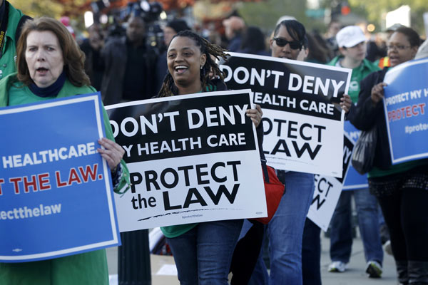 "<div class=""meta ""><span class=""caption-text "">Supporters of the health care reform law signed by President Obama gather in front of the Supreme Court in Washington, Monday, March 26, 2012, as the court begins three days of arguments on health care. (AP Photo/Charles Dharapak)</span></div>"