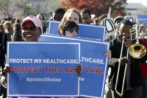 Supporters for the health care reform law signed by President Barack Obama rally in front of the Supreme Court in Washington, Monday, March 26, 2012, as the court begins three days of arguments on health care. (AP Photo/Charles Dharapak)