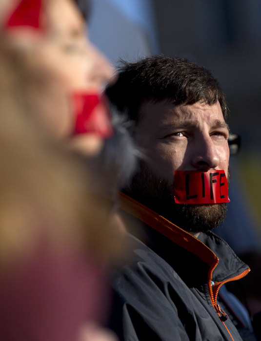 "A member of ""Bound 4 Life"" protests outside the Supreme Court in Washington, Monday, March 26, 2012, as the court began hearing arguments on the constitutionality of President Barack Obama's health care overhaul. (AP Photo/Carolyn Kaster)"