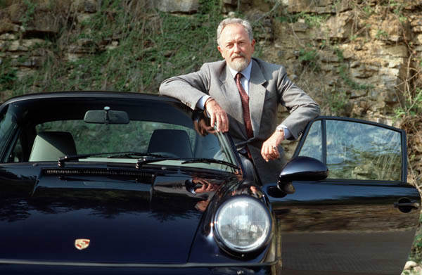 In this publicly released undated  file photo provided by Porsche AG, Car designer Ferdinand Alexander Porsche is photographed at unknown place  with a Porsche 911 Carrera. Ferdinand Alexander Porsche, the design chief credited with the classic 911 sports car and grandson of the automaker&#39;s founder, has died. Carmaker Porsche AG said Porsche was 76 and died Thursday April 5, 2012 in Salzburg, Austria. &#40;AP Photo&#47;Porsche AG&#41;    <span class=meta>(AP Photo&#47; Anonymous)</span>