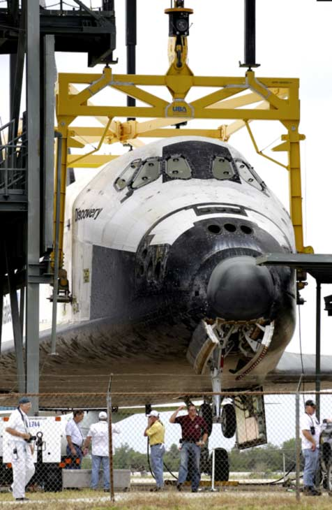 Space shuttle Discovery waits at the Mate-Demate structure to be to be mounted atop a 747 carrier jet, not pictured, at the Kennedy Space Center, Saturday, April 14, 2012, in Cape Canaveral, Fla. High winds stopped the operation and forced NASA to postpone the hoisting operation until 5 a.m. Sunday. Discovery will be transported to the Smithsonian National Air and Space Museum in Washington on Tuesday, April 17. <span class=meta>( &#40;AP Photo&#47;John Raoux&#41;)</span>