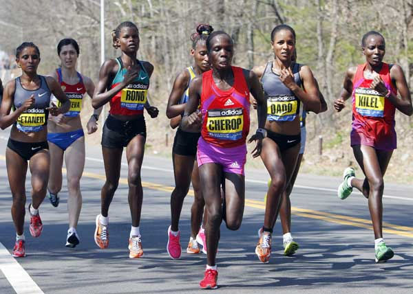 Elite women runners, including Genet Getaneh, left, of Ethiopia; Georgina Rono, third from left, and Sharon Cherop, fourth from left, of Kenya; Firehiwot Dado, second from right, of Ethiopia, and Caroline Kilel, right, of Kenya, compete in the Boston Marathon in Wellesley, Mass., Monday, April 16, 2012. (AP Photo/Michael Dwyer)