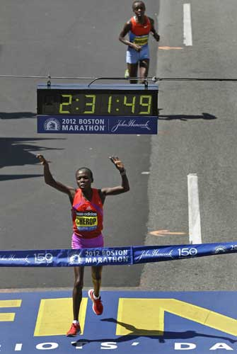 Sharon Cherop, of Kenya, edges out Jemima Jelagat Sumgong to win the women's division of the 116th Boston Marathon in Boston, Monday, April 16, 2012. (AP Photo/Charles Krupa)