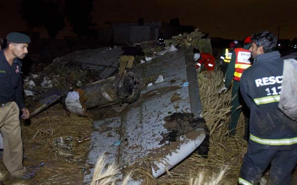 "<div class=""meta image-caption""><div class=""origin-logo origin-image ""><span></span></div><span class=""caption-text"">Pakistani rescue workers and police officers look for survivors amid the wreckage of a passenger plane which crashed on the outskirts of Islamabad, Pakistan, Friday, April 20, 2012. A Pakistani passenger jet with 127 people on board crashed into wheat fields Friday as it was trying to land in a thunder storm at an airport near the capital Islamabad. Sobbing relatives of those on the flight flocked to the airport, and officials said there appeared to be no survivors. (AP Photo/Anjum Naveed) (AP Photo/ Anjum Naveed)</span></div>"