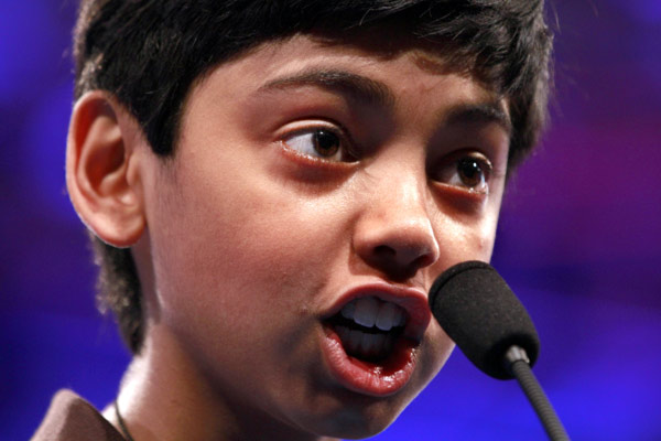 Pranav Sivakumar, 12, of Tower Lakes, Ill., spells his word during the National Spelling Bee, Wednesday, May 30, 2012, in Oxon Hill, Md.  &#40;AP Photo&#47;Jacquelyn Martin&#41; <span class=meta>(AP Photo&#47; Jacquelyn Martin)</span>