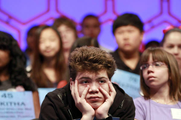 Dylan Bird, 13, of Pebble Beach, Calif., listens to fellow spellers during the National Spelling Bee, Wednesday, May 30, 2012, in Oxon Hill, Md.  &#40;AP Photo&#47;Jacquelyn Martin&#41; <span class=meta>(AP Photo&#47; Jacquelyn Martin)</span>